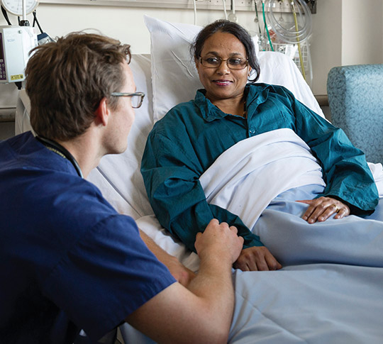 Doctor talking to a patient in a hospital bed