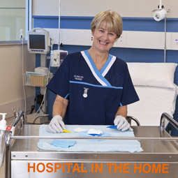 A nurse with hands on a Hospital in the Home trolley