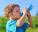 Boy drinking from a water bottle
