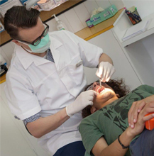 dentist examining inside of patient's mouth