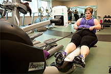 Woman using a rowing machine at the gym