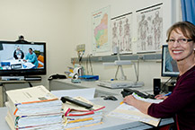 Specialist conducting an appointment with a patient via telehealth