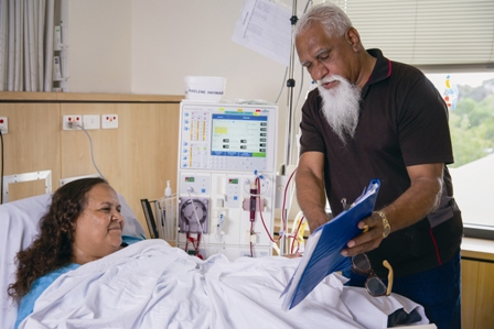 Female patient in hospital reviewing consent with her carer
