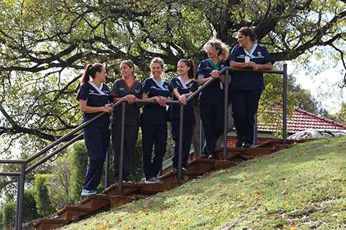 Female nurses standing on a stairway