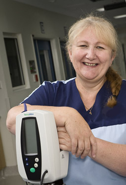 mature nurse with blood pressure machine