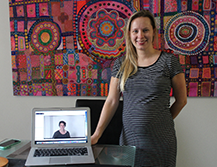 Pregnant mother with laptop displaying telehealth class