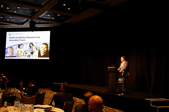 Dr David Russel-Weisz presenting at the health and medical research innovation forum