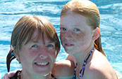 mother and daughter in swimming pool together