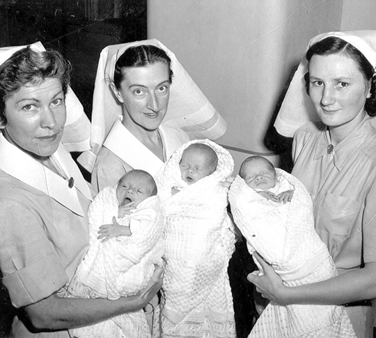 Old Photo of three nurses from King Edward Memorial Hospital holding newborn babies