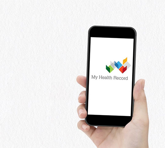 Hand displaying Iphone with the My Health Record Logo on screen