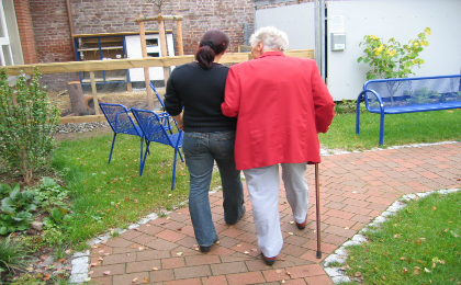 Elderly lady and carer walking