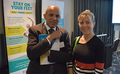 Dr Sudhakar Rao (left) and Dr Kate Ingram (right) stand in front of Stay on Your Feet falls prevention banner.