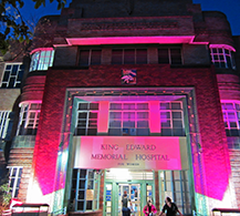Entrance to King Edward Memorial Hospital with pink lighting