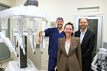 Dr Matt Brown, Urological Surgeon, Janet Zagari Executive Director Fiona Stanley Fremantle Hospital (FSFHG) and Professor Dickon Hayne FSFHG Head of Urology next to the new da Vinci surgical system