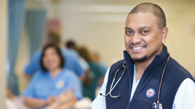 Male nurse smiling at camera