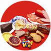 Processed meats and sugary and salty snacks on red background