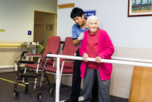 Elderly Patient attempting to walk again during rehabilitation session