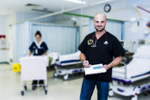 Emergency Department doctor fills in patient report on hospital ward