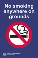 "Sign displaying a no smoking symbol with a line through a burning cigarette and text ""No smoking anywhere on grounds"""