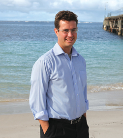 man near beach in business clothes