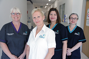 Four female maternity nurses and midwives